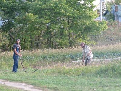 Sam and Aerron scything hay
