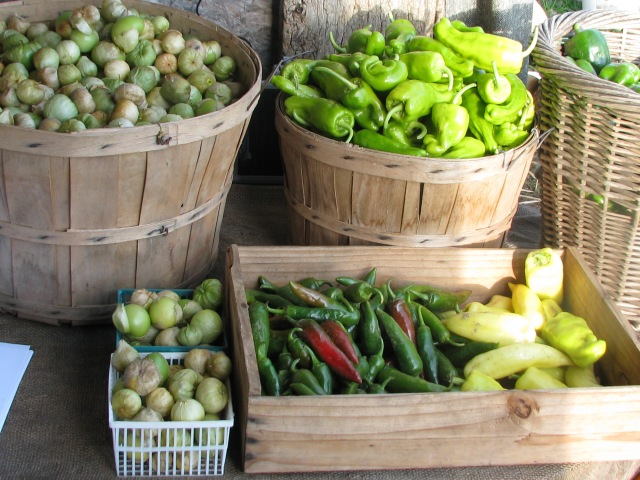 Tomatillos and several pepper varieties ready for sharers pickup.