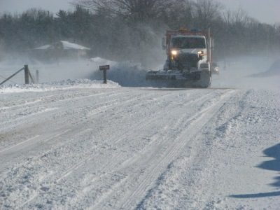 The County snow plow on Green's road  near Robinson at times nearly obscured by blowing snow.