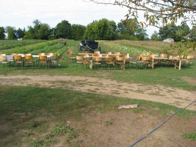 The four new harvest tables along with chairs not yet properly set up prior to everyone arriving for the potluck.