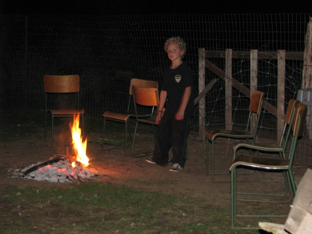 Gabriel at the after the potluck campfire .